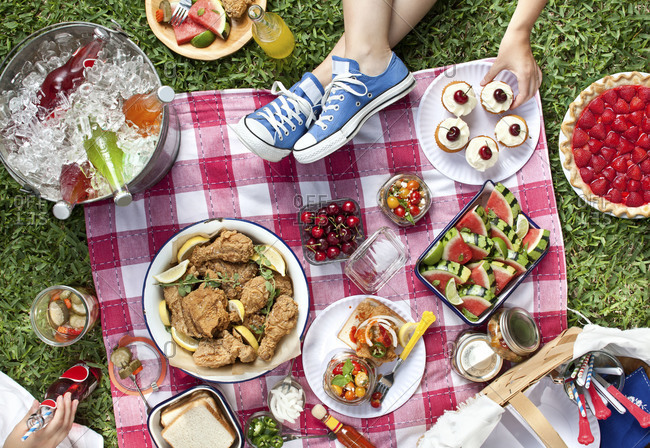 Overhead of a colorful summer picnic lunch