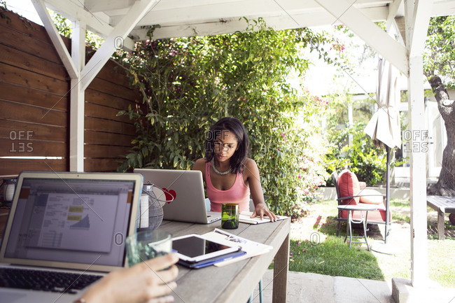 Women working on laptops outdoors