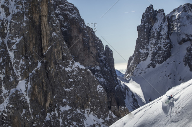 Person snowboarding in the Dolomites