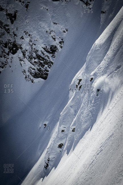 Person snowboarding down a steep slope