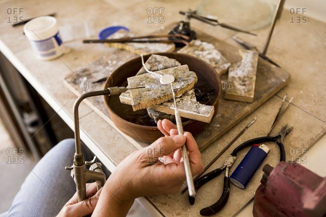 Close up shot of woman making jewelry