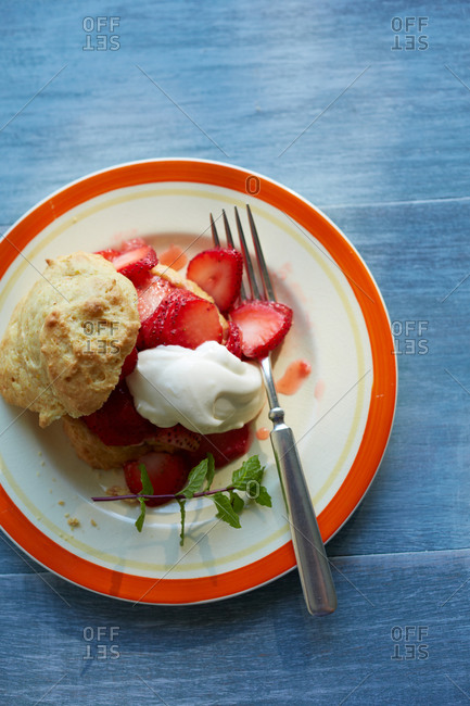 Strawberry shortcake and whipped cream and mint