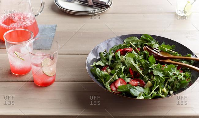Pink lemonade and arugula salad