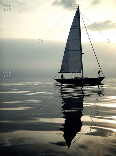 A couple steers a sailboat