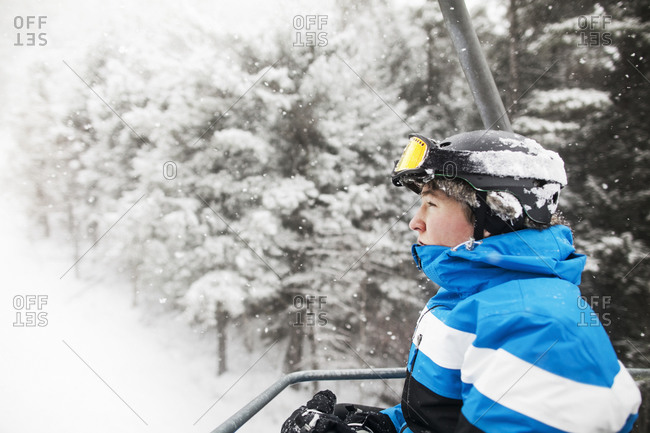 A teen rides a ski lift in the Catskills