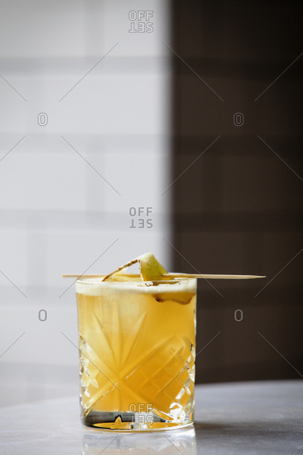A Bonny Lad cocktail served with a ginger slice