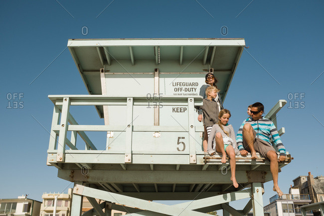 Family relaxing on a lifeguard tower