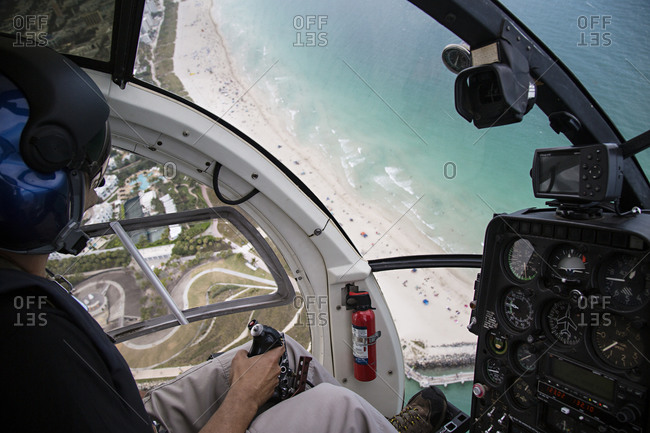 Pilot in helicopter cockpit over Florida