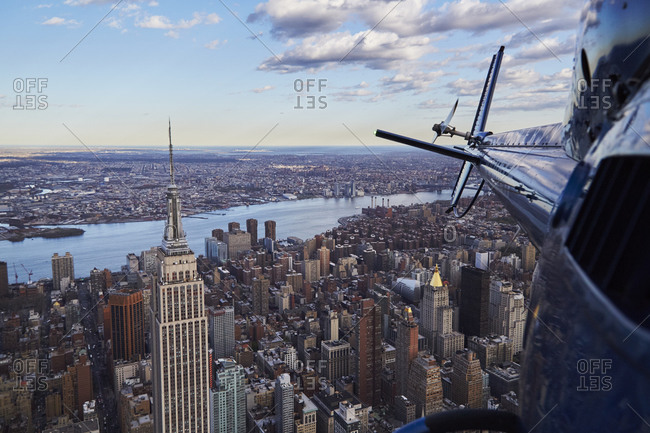 New York City, New York - April 28, 2015: Helicopter tail over Empire State Building