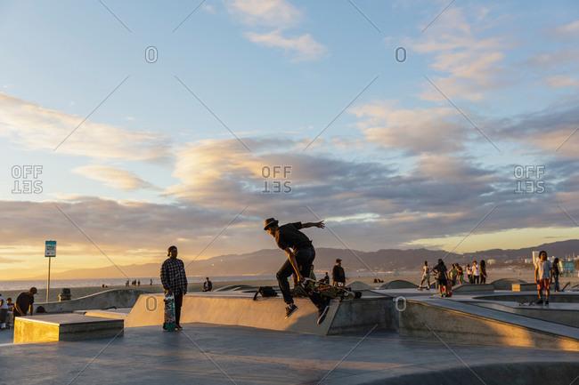 Venice Beach Skate Park, California, USA - November 20, 2014: People at a Venice Beach skate park at sunset, California