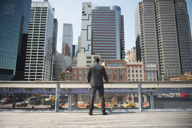 Businessman looking over city