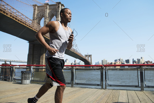 Man jogging near Brooklyn Bridge
