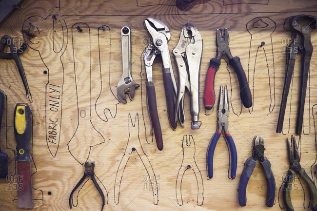 Pliers on board in workshop