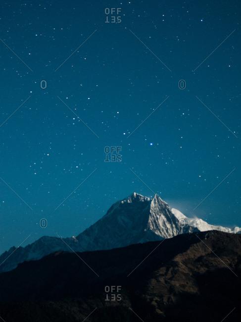 Mountain peak under night sky