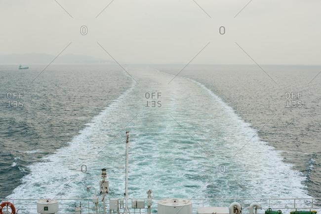Ferry leaving wake on ocean
