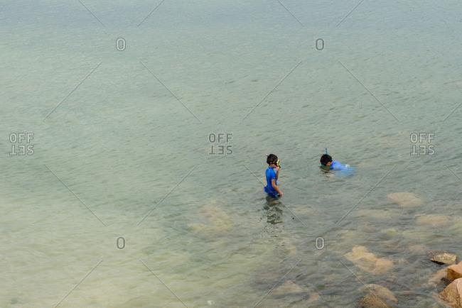 Osaka, Japan - August 15, 2014: Two boys snorkeling in Japan