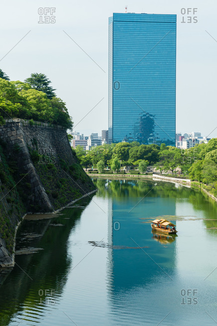 Waterway of Osaka Castle with skyscraper