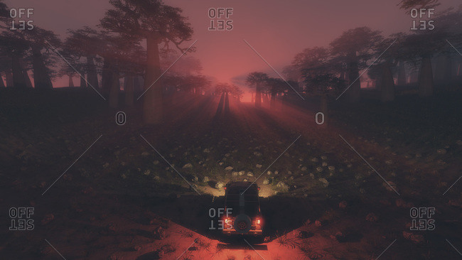 Four-wheel drive vehicle at the edge of a rock field and with a mysterious pink light coming through the trees