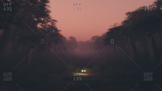 Four wheeled drive vehicle driving on isolated road through a dark forest under a pink sky