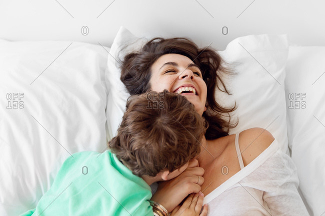 A little boy tickles his mom