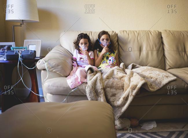 Little girls doing nebulizer treatment