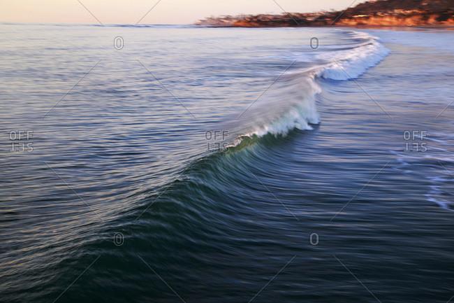A wave breaks in Pacific Beach, a beach community in San Diego, CA