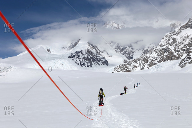 A team of mountaineers are roped up while crossing the Kahiltna glacier on their way to Mount McKinley in Alaska