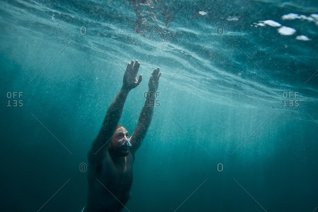 A free diver swims through clear water off the coast of Catalina Island, CA