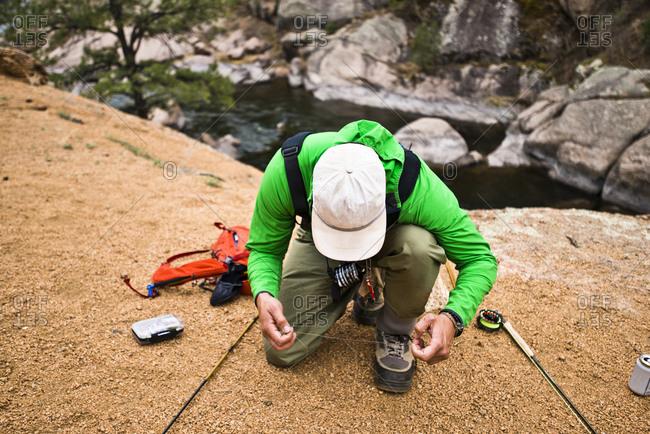 A fly fisherman prepares his gear in Cheeseman Canyon, Colorado