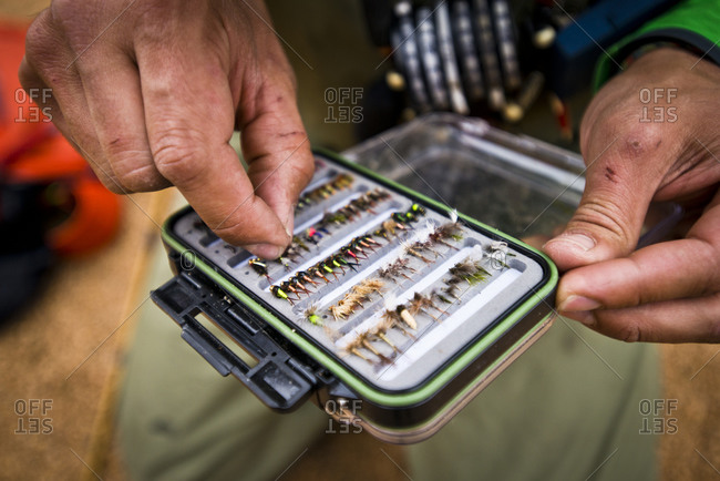 Close-up shot of a fly fisherman's fly box