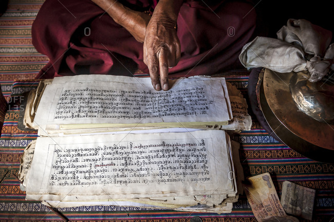 A monk with Buddhist scriptures in Hemis monastery, Ladakh, India