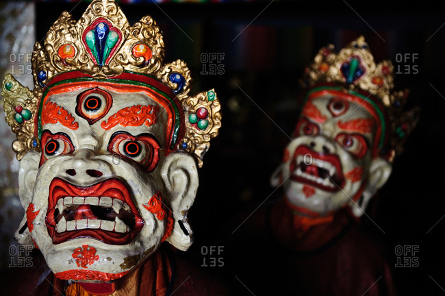 Buddhist ritual masks during Spitok Gustor ceremony in Spitok Monastery, Ladakh, India
