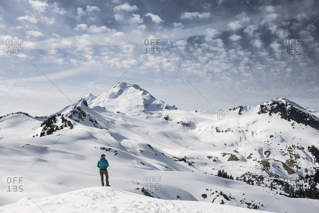 A woman enjoys the view of Mount Baker on a winter trip into Washington's Mount Baker Wilderness Area