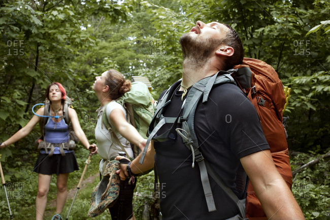 Appalachian Trail thru hikers trying to seek relief from the heat as rain falls from the sky