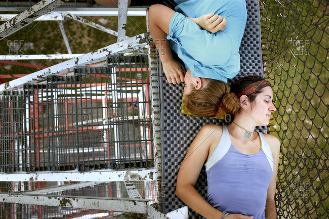 Two females napping in the cool breeze atop the tower