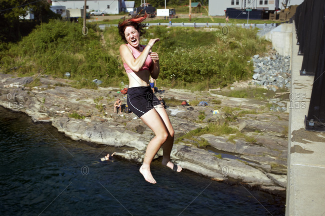 Female screams as she leaps from a bridge into the water