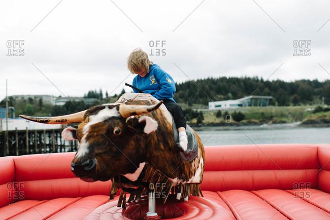 Boy riding a mechanical bull