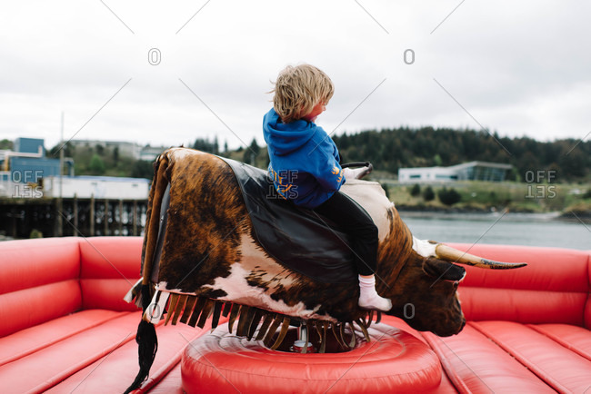 Young boy riding a rodeo bull