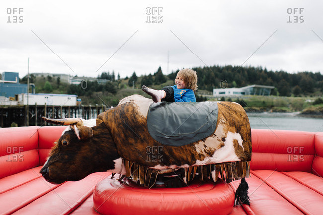 Boy falling off a mechanical bull