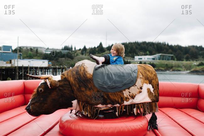 Boy falling off a mechanical bull