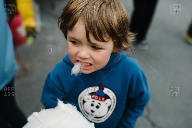 Portrait of boy eating cotton candy
