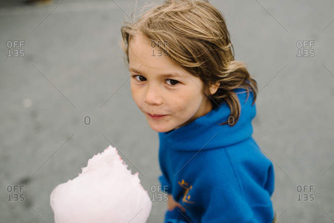 Boy with pink cotton candy