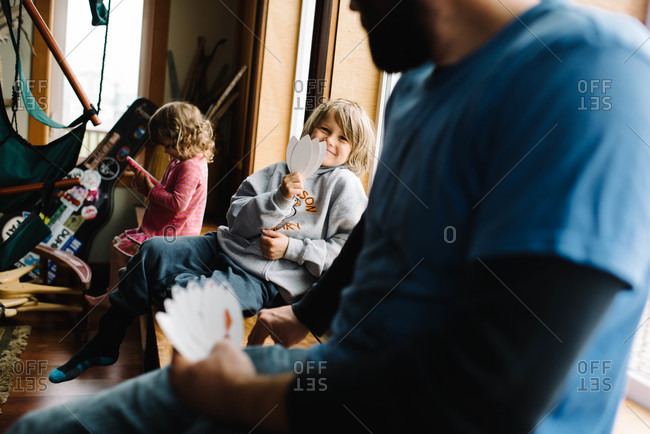Father and son playing a card game