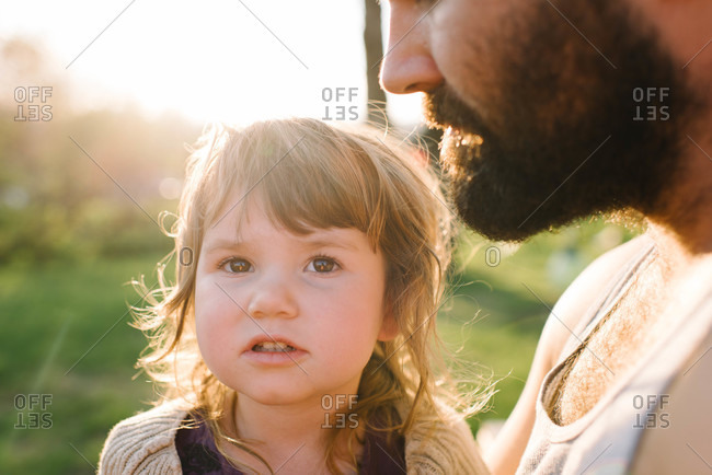 Little girl sitting with her father