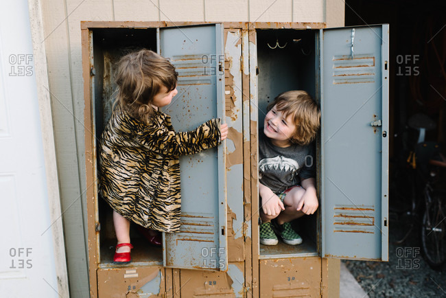 Children playing in an old locker