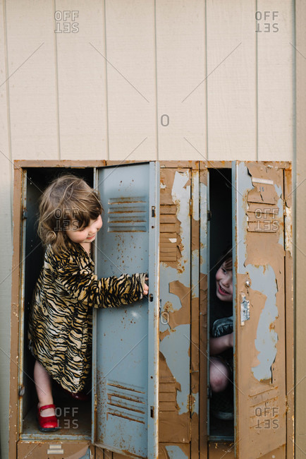 Boy hiding in a locker from his sister