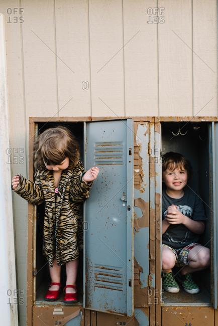 Siblings playing in a locker