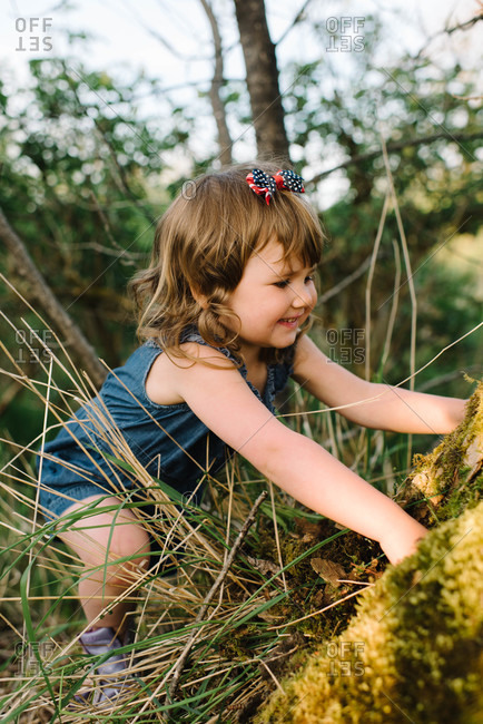 Little girl playing in nature