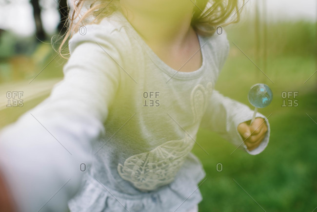 Close up of girl holding a lollipop