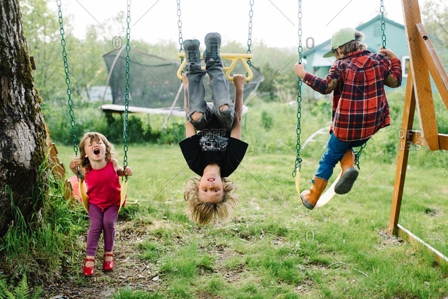 Children playing at a swing